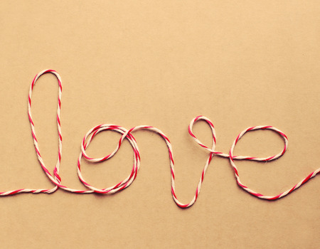 The word \love\ written with rope, retro filter effect photo