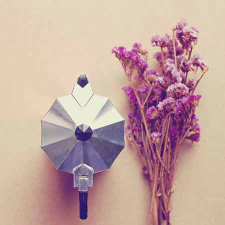 with coffee maker: Italian coffee maker and flower with retro filter effect Stock Photo