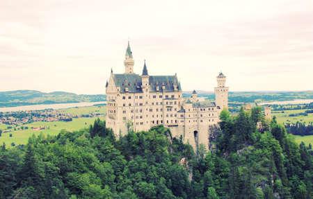 schwangau: Neuschwanstein Castle in Bavaria, Germany with Retro Filter Effect Editorial