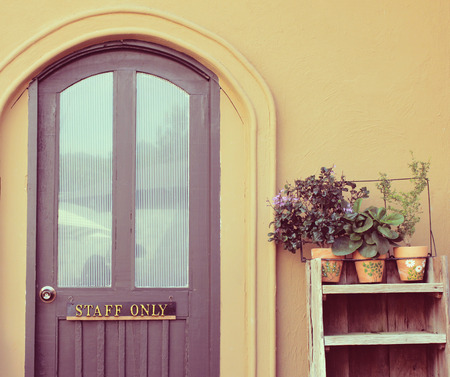 Staff only on door with flower pot for decorated, retro filter effect photo