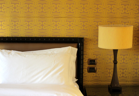 king size: Close up of pillow on king size bed in hotel room Stock Photo