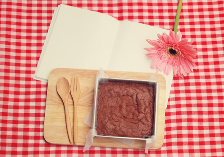 homemade style: Homemade brownie on blank notebook with retro filter effect