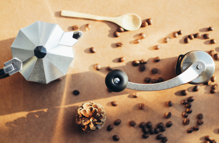 with coffee maker: Coffee maker and grinder with coffee beans, retro filter effect Stock Photo