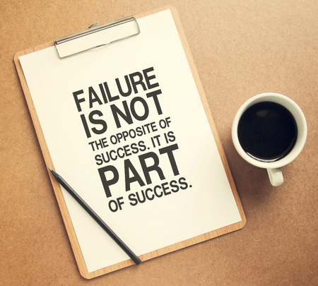 Inspirational motivating quote on clipboard and cup of coffee with retro filter effect Standard-Bild