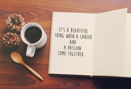 motivating: Inspirational motivating quote on notebook and coffee with retro filter effect