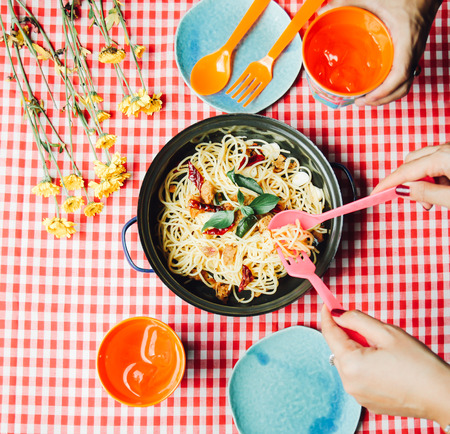 picnic tablecloth: Eating homemade spaghetti with friend