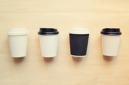identities: Paper coffee cup mock up for identity branding with retro filter effect