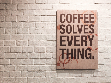 canvas art: Inspirational motivating quote about coffee on canvas frame hanging on brick wall in the cafe Stock Photo