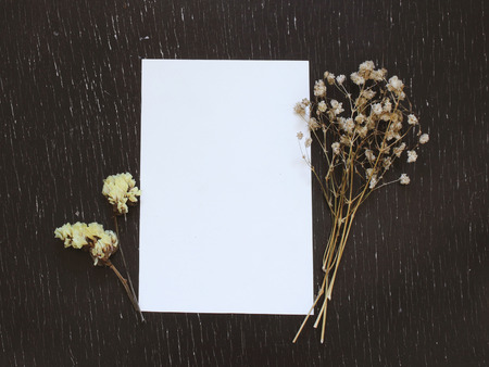 handmade: Blank greeting card with flower on rustic wood background for creative work design Stock Photo