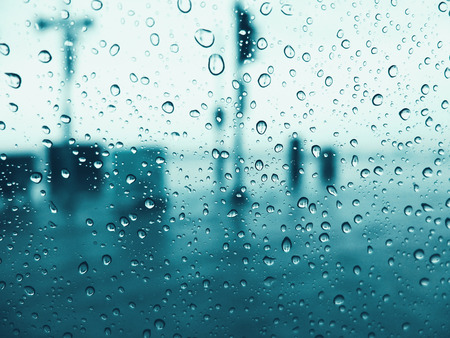 blue  toned: Drops of rain on glass window with blue toned color