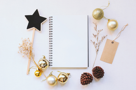 gold ornament: Craft and notebook mock up with christmas ornaments on white wood background Stock Photo