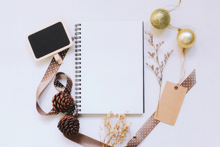 wood craft: Craft and notebook mock up with christmas ornaments on white wood background Stock Photo