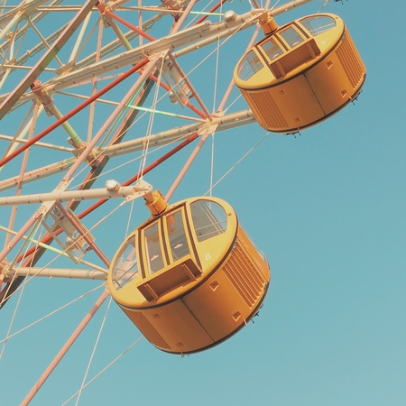 construction: Ferris wheel with clear blue sky, pastel tone