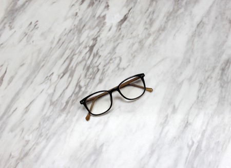 Eyeglasses on black and white marble table texture Stock Photo