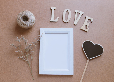 photo frame: Photo frame mockup and craft decorated with love wooden alphabet