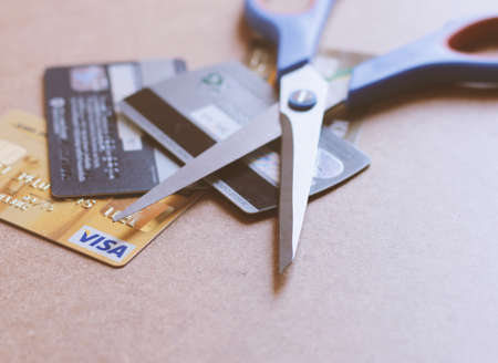 economic depression: Scissors on various of credit card prepare to cut
