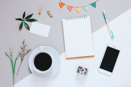 Creative flat lay design of cute workspace desk with notebook, coffee, smartphone and decorated cute craft with copy space background, minimal style Stockfoto