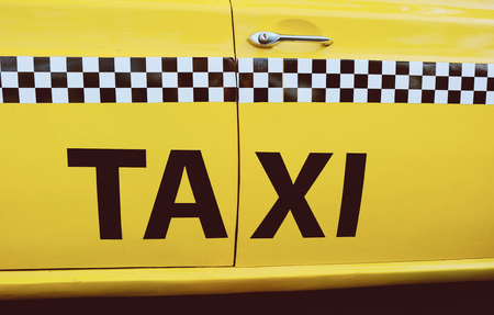 door handles: The side of New York City yellow taxi cab Stock Photo