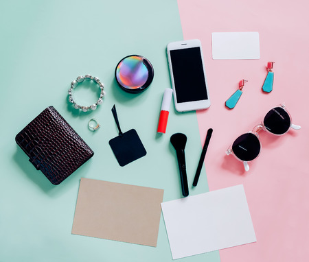 flat lay of accessories items on colorful background Banco de Imagens