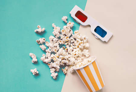 Flat lay of cinema items, 3d glasses and popcorn on colorful bright background with retro style, entertainment concept Stock Photo
