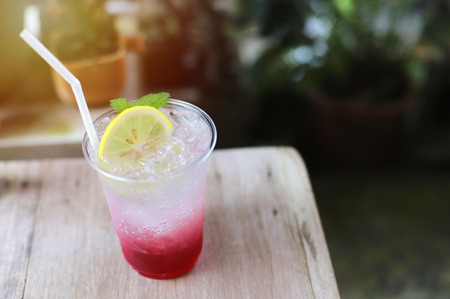Summer tasty drink, fresh lemon iced with soda and berry in the cafe, summer concept