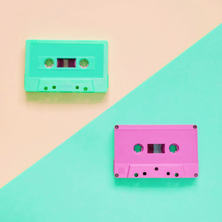 Flat lay retro colorful cassette tape on pastel color background, minimal style Stock Photo