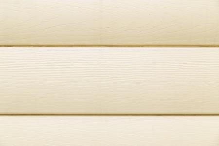 siding: House siding. Yellow plastic panel siding texture.
