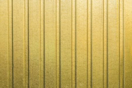 metall texture: Texture background of yellow corrugated metall fence