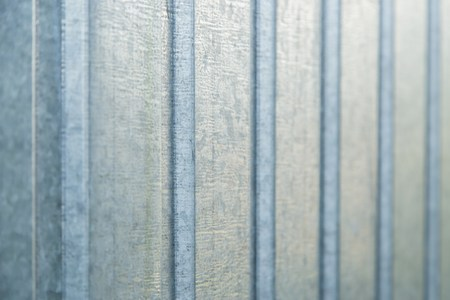 holed: Corrugated metal sheet wall background wall texture Stock Photo