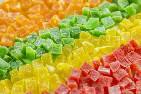 candied fruits: Dried pineapple, candied fruits in a row, four colors Stock Photo