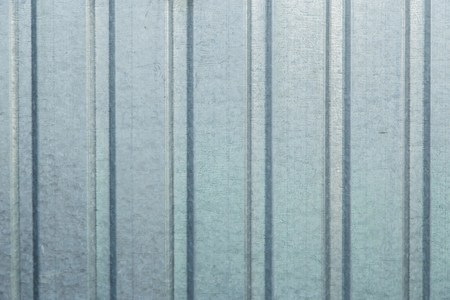 corrugation: Old blue galvanized metal sheet, background wall Stock Photo