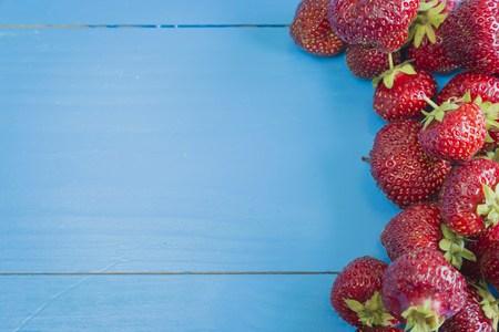 copyspase: Fresh strawberries on blue wooden background, copyspase