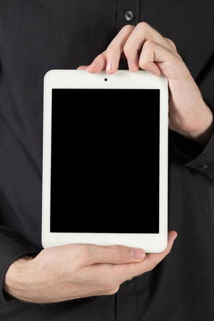 blank tablet: touch-tablet in hand, man show blank tablet Stock Photo