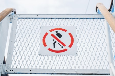 no entrance: No entry sign on cruise ship. The sign is a universal red colored round circle with a person inside. Stock Photo