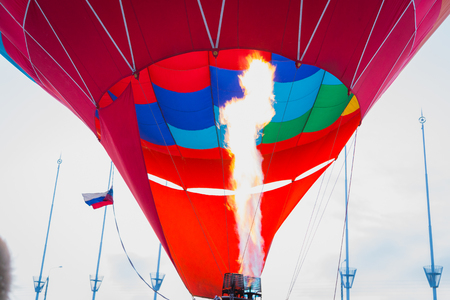 Balloon crew inflates envelope of hot air balloon at festival Banco de Imagens