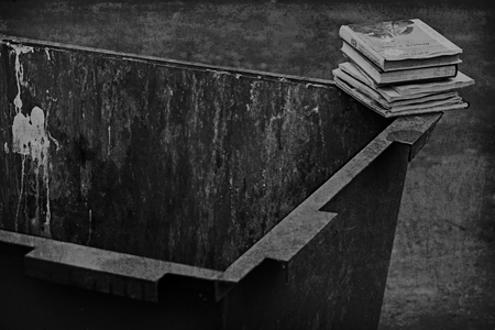 books in the trash can shot on b/w