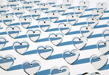 Many white glass hearts on white background