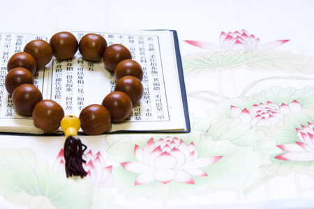 仏教聖典と数珠 写真素材