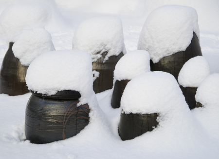 White snow accumulated on the crock Stock Photo
