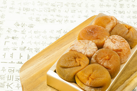 Dried Persimmon inside tray background.