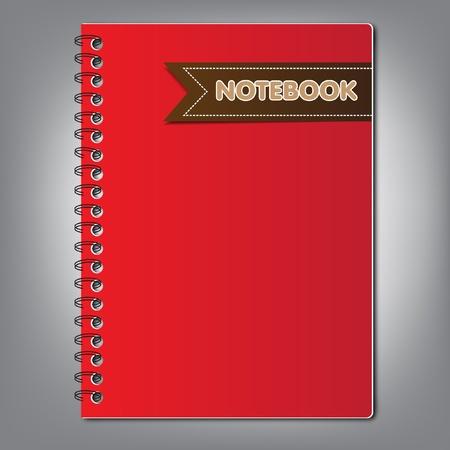 cuaderno rojo con la etiqueta label