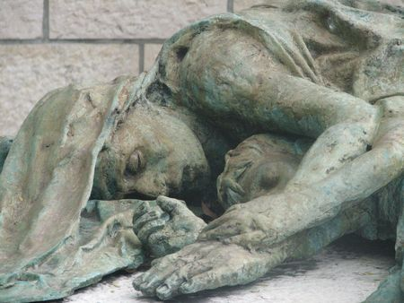 holocaust: Part of the holocaust memorial in Miami Florida, USA, stone statue of mother holding her child in her arms