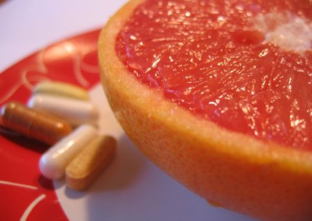 Pink Grapefruit with Vitamins Stock Photo