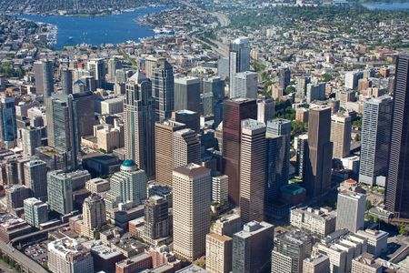 Aerial view of downtown Seattle, Washington with skyscrapers and Lake Washington in the distance photo