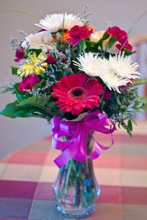 Beautiful vibrant bouquet of flowers in a glass vase