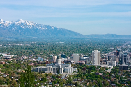 View of Salt Lake City, Utah on a sunny day with mountains in the background photo
