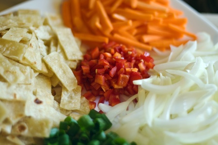 Platter of cut up vegetables and tortillas