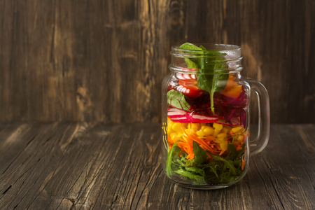 gass: Healthy homemade veggies salad in mason jars. Natural light. Vintage style. Selective focus