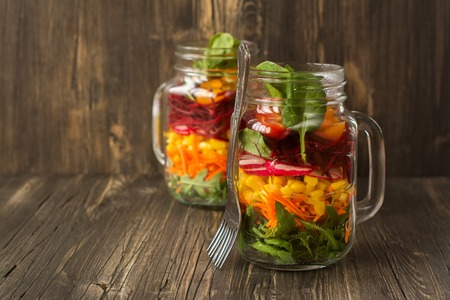 gass: Healthy homemade vegetable salad in mason jar. Rustic style. Selective focus Stock Photo