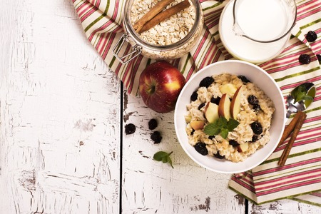 Oatmeal porridge with dry cranberry and apple
